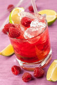 Red drink with raspberries and ice — Stock Photo