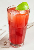 Red drink with cranberry and grapefruit — Stock Photo