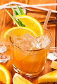 Drink with orange and pineapple — Stock Photo