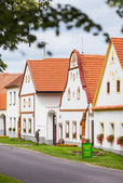 HOLASOVICE, CZECH REPUBLIC - AUGUST 11, 2012: Village Holasovice, UNESCO World Heritage Site. Buildings in the baroque style. — Stock Photo