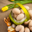 Stock Photo: Easter decoration with rabbit, eggs and tulip