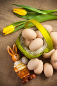 Easter decoration with rabbit, eggs and tulip — Stock Photo