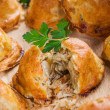 Baked bread stuffed with cabbage and mushrooms - Stock Photo