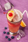 Drink with lemon and cherry — Stock Photo
