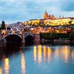 Prague, Czech Republic Night panorama of Hardcany with Vltava river — Stock Photo #26816367