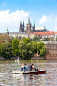 Prague, Czech Republic - May 8, 2013: Vltava river with floating in boats. In the background - Hradcany. UNESCO. — Stock Photo