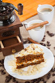 Coffee grinder, cup of coffee and cake — Stock Photo