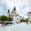 Prague, Czech Republic - May 07, 2013: Prague, capital of Czech Republic. Market of the old city and saint Nicholas church. — Stock Photo