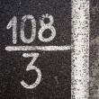 Numbers and digits on the asphalt — Stock Photo