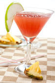 Red drink with pineapple — Stock Photo