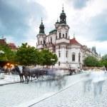 Prague, Czech Republic - May 07, 2013 Prague, capital of Czech Republic Market of the old city and saint Nicholas church — Stock Photo #30041379
