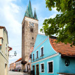 Telc, Czech Republic - May 10, 2013: Holy Spirit Lutheran Church and restaurant in blue colour in Telc, Unesco city — Stock Photo