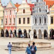 Stock Photo: Telc, Czech Republic - May 10, 2013: Tourists walks around main marget in Telc, Unesco city