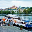 Prague, Czech Republic - May 07, 2013: Danubio boat moored to bank of river Vltavin Prague — Stock Photo #31003635