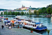 Prague, Czech Republic - May 07, 2013: Danubio boat moored to the bank of the river Vltava in Prague — Foto de Stock