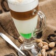Coffee latte, pistachios flavor — Stock Photo