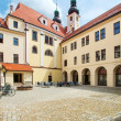 Telc, Czech Republic - May 10, 2013  Unesco city, Courtyard The Baroque Church of the Name of Jesus — Stock Photo