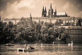 Prague, Czech Republic - May 8, 2013 Vltava river with people floating in boats In the background - Hradcany UNESCO — 图库照片