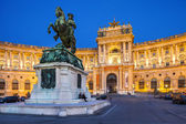 Vienna, Austria - August 30. 2013. Hofburg Palace Was home for the most powerful people in European and Austrian Habsburg dynasty. Statue of Emperor Joseph Evening view with illuminated building — Stock Photo