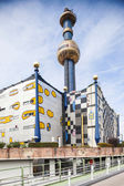The most famous District heating in Vienna, Austria of artist Hundertwasser Characteristic gold and blue chimney of heating plant is visible from many places of Vienna. — Stok fotoğraf