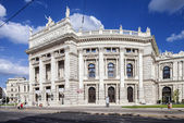 Vienna, Austria - September 01.2013. People walks next to Burgtheater-Imperial Court Theater. Theater moved to this building designed by Gottfried Semperand Karl Freiherr von Hasenauer. — Stock Photo