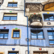 Vienna, Austria. Detail picture of the Hundertwasserhaus, colored building. — Foto de Stock