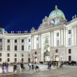 Vienna, Austria - August 30, 2013: Main entrance to Hofburg palace. Evening view of the illuminated building of Hofburg Palace viewed from Michaeler Platz. — Stock Photo