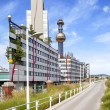 The most famous District heating in Vienna, Austria of artist Hundertwasser  Characteristic  gold and blue chimney of heating plant is visible from many places of Vienna — Stock Photo