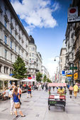 Vienna, Austria - September 01, 2013: Tourists form all over the World walks among one of the main streets, Kartner Strasse form Wiener City Opera to Stephansplatz. — Stock Photo