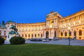 Vienna, Austria - August 30, 2013: Hofburg Palace. Was home for the most powerful people in European and Austrian Habsburg dynasty. Statue of Emperor Joseph II Evening view with illuminated building — Stock Photo
