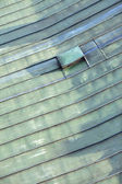 Detail of the roof top covered by copper sheet coated with a patina — Stock Photo
