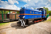 Przyslup, Poland - July 18, 2013: Blue Narrow-gauge railway, steam train. Tourist train rides in the summer from Cisna to Przyslup in Bieszczady mountains — Stock Photo