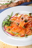 Carpaccio made from salmon — Stock Photo