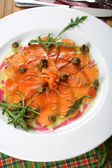 Carpaccio made from salmon, top view — Stock Photo