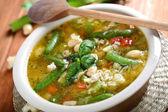 Bullion with pore and basil, italian soup — Stock Photo