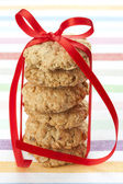 Six oatmeal cookies tied with a red ribbon — Stock Photo
