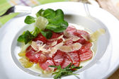 Carpaccio made from beef — Stock Photo