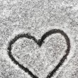 Heart shape drawn with the snow — Stock Photo
