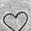 Heart shape drawn with the snow — Stock Photo #39642447