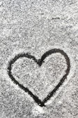 Heart shape drawn with the snow — Stockfoto