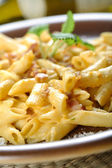 Macaroni with bitter dressing, carbonara sauce — Stock Photo