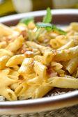 Macaroni with bitter dressing, carbonara sauce — Stock Photo