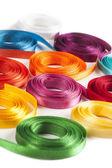 Coiled spools of colorful ribbons on a white background — Stock Photo