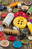 Set of colored sewing buttons on wooden background — Stock Photo