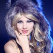 Girl in a wolf hat — Stock Photo