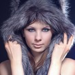 Stock Photo: Girl in a wolf hat