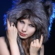 Girl in a wolf hat — Stock Photo #18613901