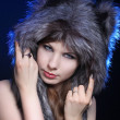 Stock Photo: Girl in wolf hat