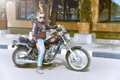 Boy on motorbike — Stock Photo