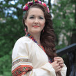 Woman in traditional Russian (slavic) costume — Stock Photo